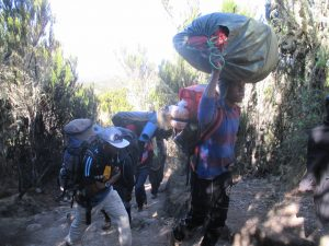 Guides and staff carrying equipment